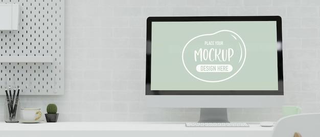 Moderner arbeitsplatz mit computer, schreibwaren und dekorationen auf dem schreibtisch im weißen ziegelwandraum, 3d-rendering, 3d-darstellung