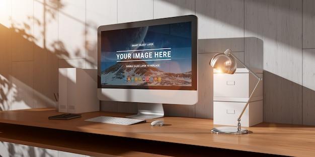 Moderner bürodesktop mit computer- und sonnenlichtmodell