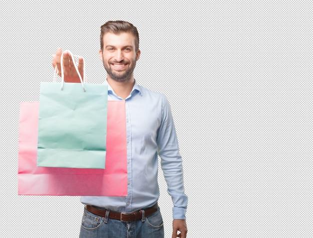 Moderner mann, der einkaufstaschen hält
