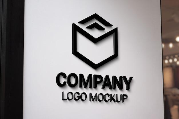 Modernes 3d-logo mit schwarzem logo auf weißer eingangswand. branding-präsentation