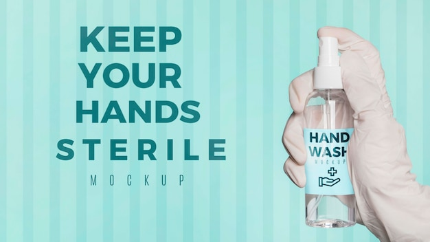 Nahaufnahme hand, die desinfektionsmittel hält