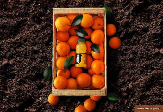 Orangensaftflasche über orangenbox