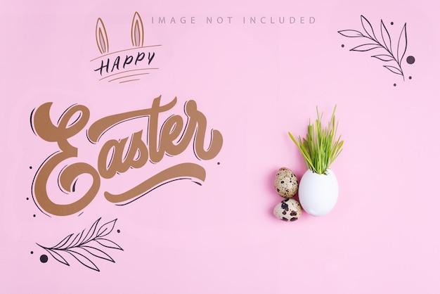 Ostergras wächst in eierschalen- und wachteleiern auf einer rosa modelloberfläche. öko-konzept