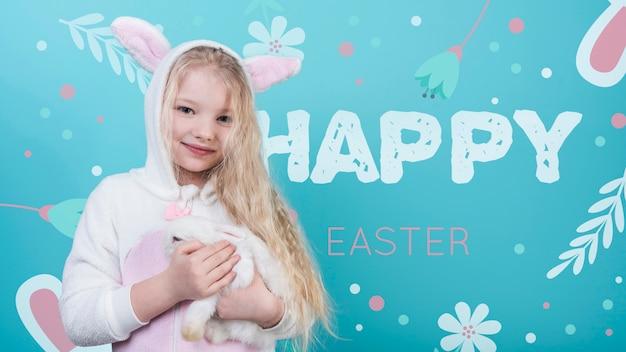 Ostern-modell mit mädchen und kaninchen