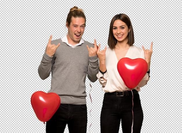 Paar am valentinstag rock geste machen Premium PSD