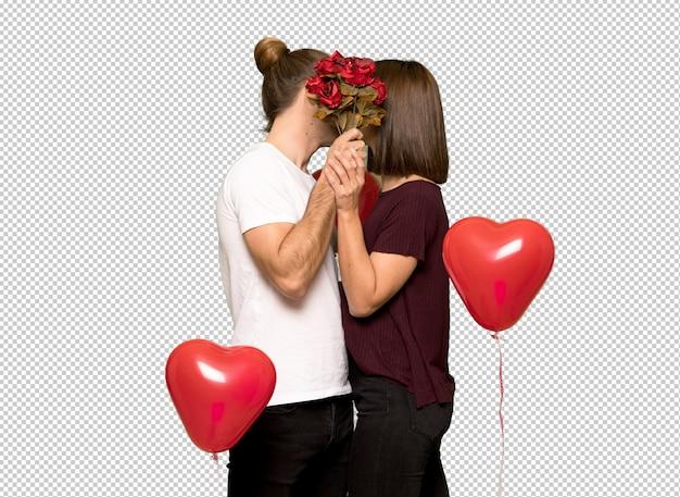 Paar im valentinstag mit blumen und küssen