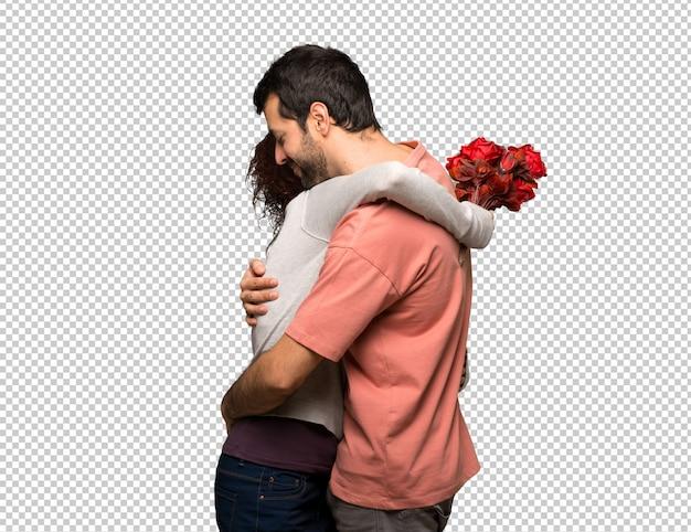Paar im valentinstag mit blumen