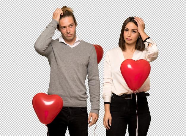 Paar im valentinstag mit einem ausdruck der frustration und nicht zu verstehen