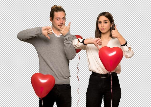 Paare am valentinstag, der gut-schlechtes zeichen macht. unentschieden zwischen ja oder nein
