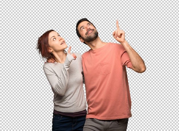 Paare am valentinstag, der oben mit dem index zeigt