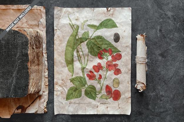 Papierblatt mit einem alten buch und schriftrollenmodell