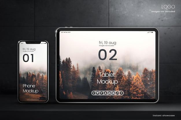 Premium-smartphone-bildschirmmodell und tablet-bildschirmmodell auf dunklem hintergrund