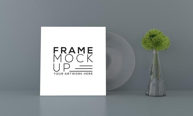 Quadratisches rahmenmodell mit ziergras in exquisiter vase