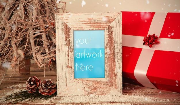 Rahmen mit weihnachtsgeschenk mockup