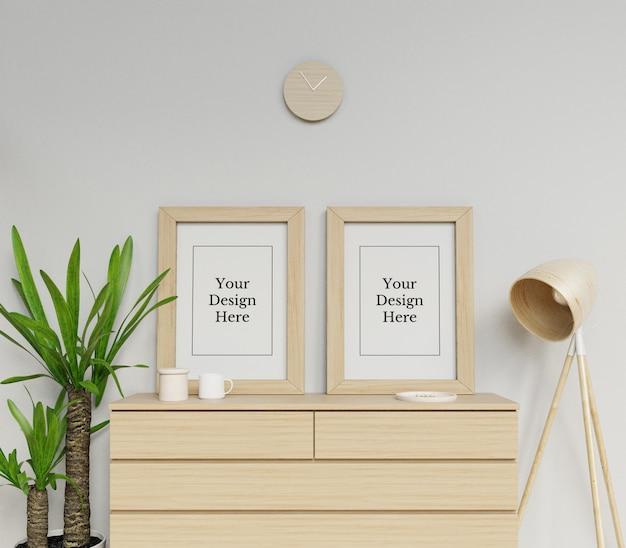 Realistische doppelte plakat-rahmen-modell-design-schablone, die porträt im minimalistischen innenraum sitzt