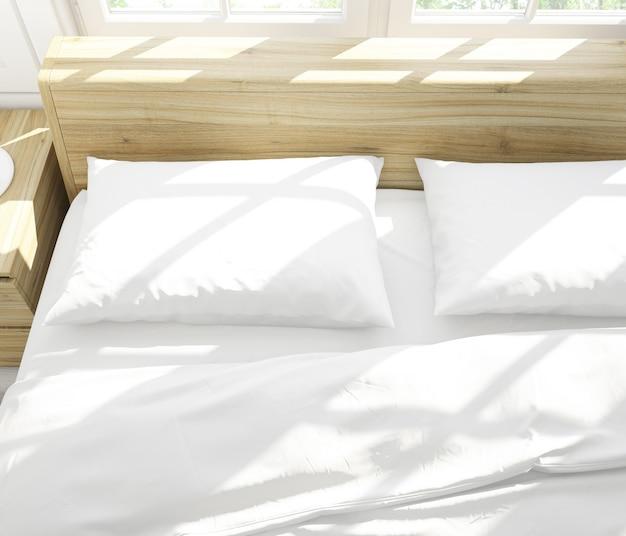 Realistische weiße kissen auf einem doppelbett