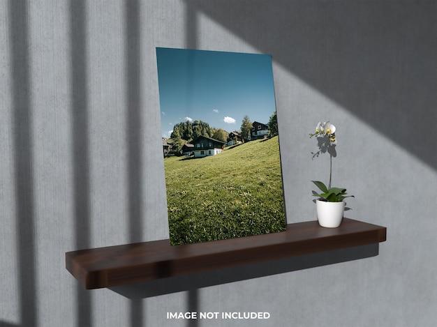 Realistischer bilderrahmen des draufsichtmodells mit blume