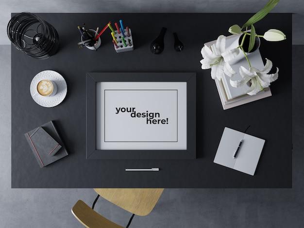 Realistischer einzelner grafik-rahmen verspotten herauf stillstehende landschaft der design-schablone auf schwarzer tabelle im modernen innenarbeitsplatz