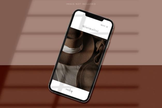 Realistischer mockup scene creator für mobile smartphones mit schattenüberlagerung. vorlage für die gestaltung der globalen business-website-design-app für die markenidentität