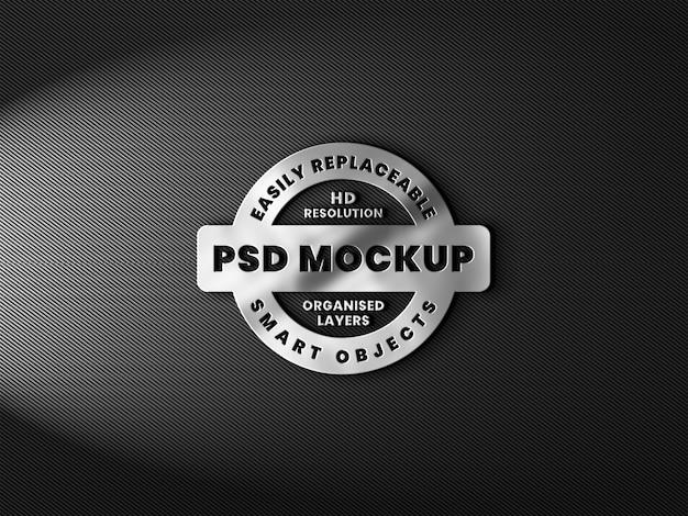 Realistisches 3d-logo-modell mit metallischer textur und reflexion auf kohlefaser
