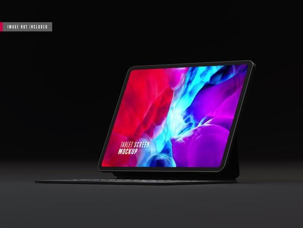 Realistisches dunkles tablet pro-modell mit tastatur