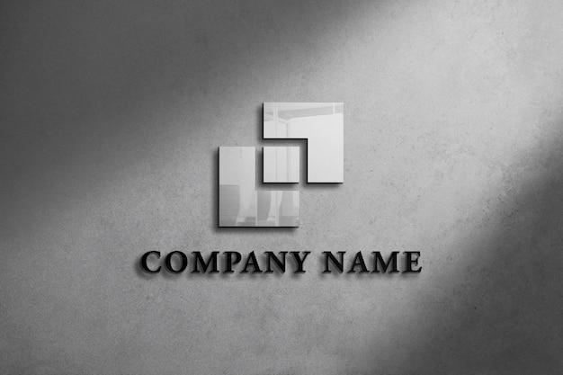 Realistisches logo-modell an der wand mit grauem hintergrunddesign