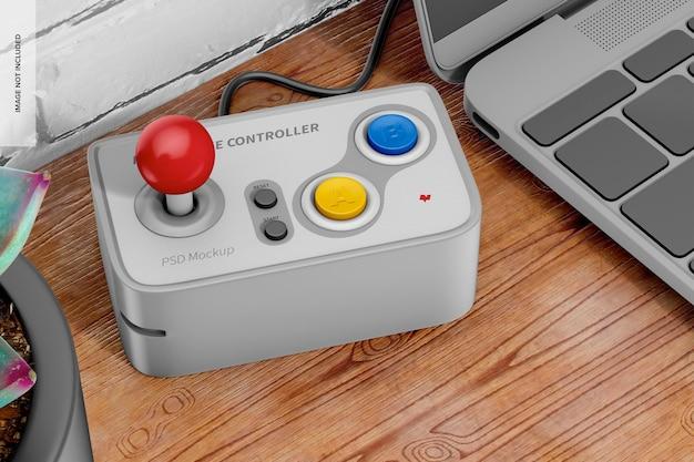 Retro game controller auf dem schreibtisch mockup
