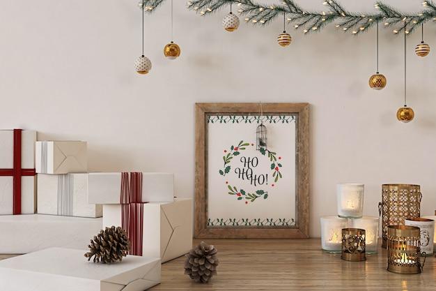Rustikales plakatrahmenmodell mit weihnachtsdekoration und -geschenken