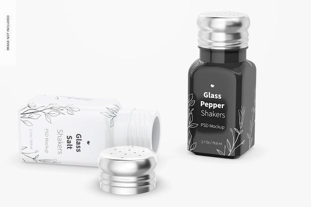 Salz- und pfefferstreuer aus glas mockup, stehend und fallengelassen