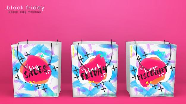 Satz von drei hellen und bunten papiereinkaufstaschenmodellen im hellen rosa raum für förderungskampagnen und black friday-verkäufe, psd-modell