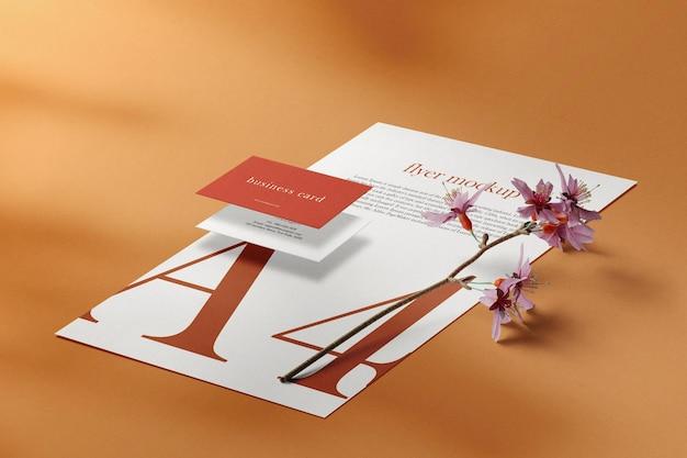 Sauberes minimales visitenkartenmodell auf papier a4 mit pflanze