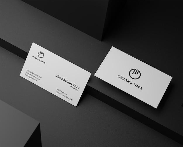 Sauberes minimales visitenkartenmodell auf schwarzem hintergrund