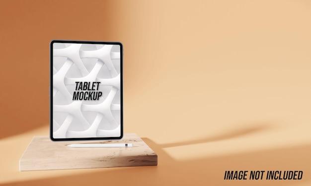 Schließen sie oben auf tablettenmodell, das auf marmor steht