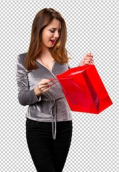 Schönes junges mädchen mit einkaufstasche