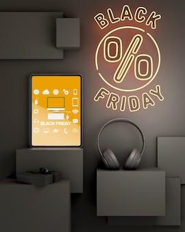 Schwarzer freitag-hintergrund mit gelben neonlichtern und tablette