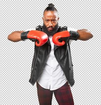 Schwarzer mann, der mit boxhandschuhen kämpft