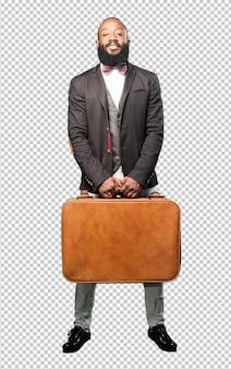 Schwarzer mann des vollen körpers, der eine ledertasche hält