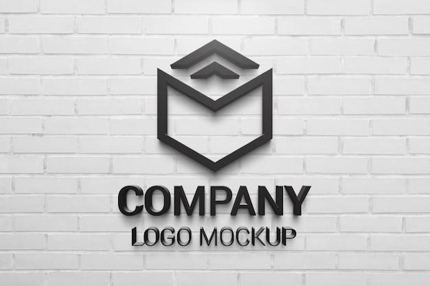 Schwarzes 3d-logo-modell auf weißer backsteinmauer. präsentation des unternehmensbrandings