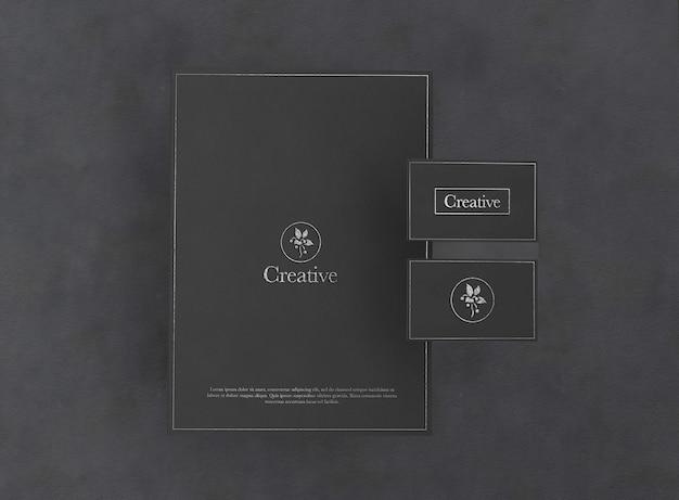 Schwarzes elegantes logo und papierkartenmodell