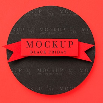 Schwarzes freitagsband der draufsichtmodell auf rotem hintergrund