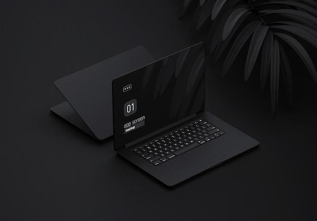 Schwarzes laptop-modell mit schwarzen blättern