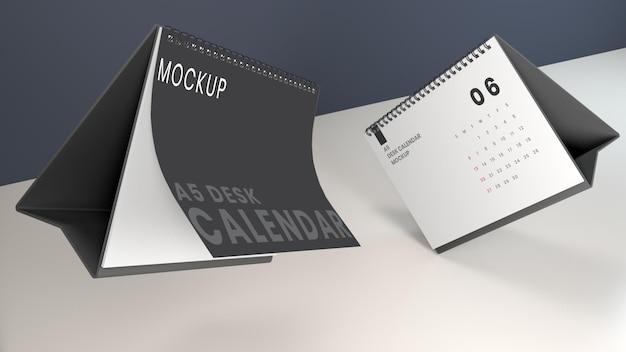 Schwebendes high angle desk calendar mockup
