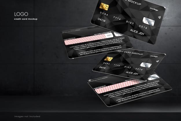 Schwebendes kredit- und debitkartenmodell auf dunklem, edlem hintergrund