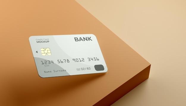 Schwimmendes single-kreditkartenmodell mit bühnenhintergrund.