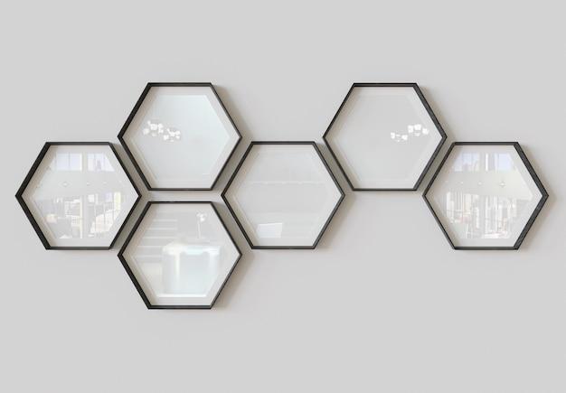Sechseckige bilderrahmen, die an der wand hängen mockup
