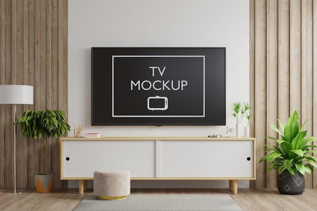 Smart tv an der weißen wand im wohnzimmer