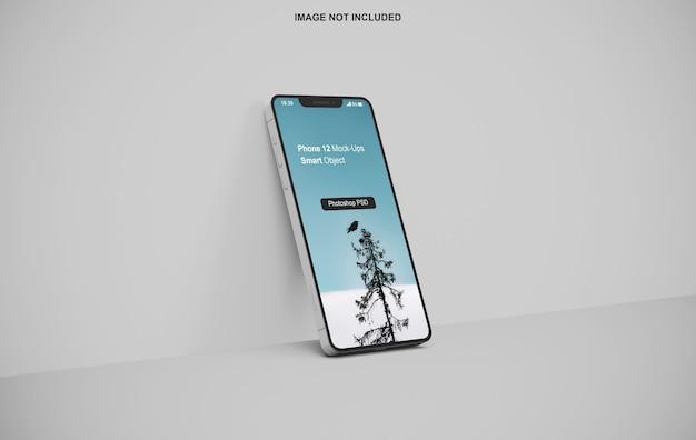 Smartphone-modell, das gegen die wand steht