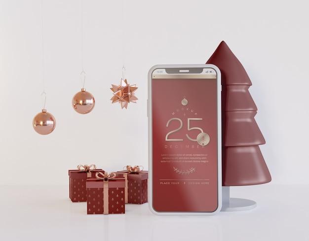 Smartphone-modell mit weihnachtsdekoration