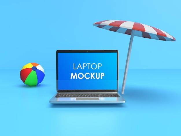 Strandball und regenschirm mit laptop laptop mockup