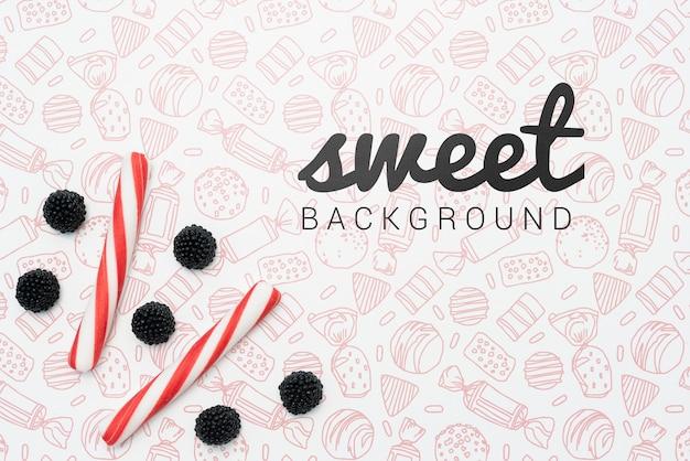 Süßer hintergrund mit süßigkeiten und beeren